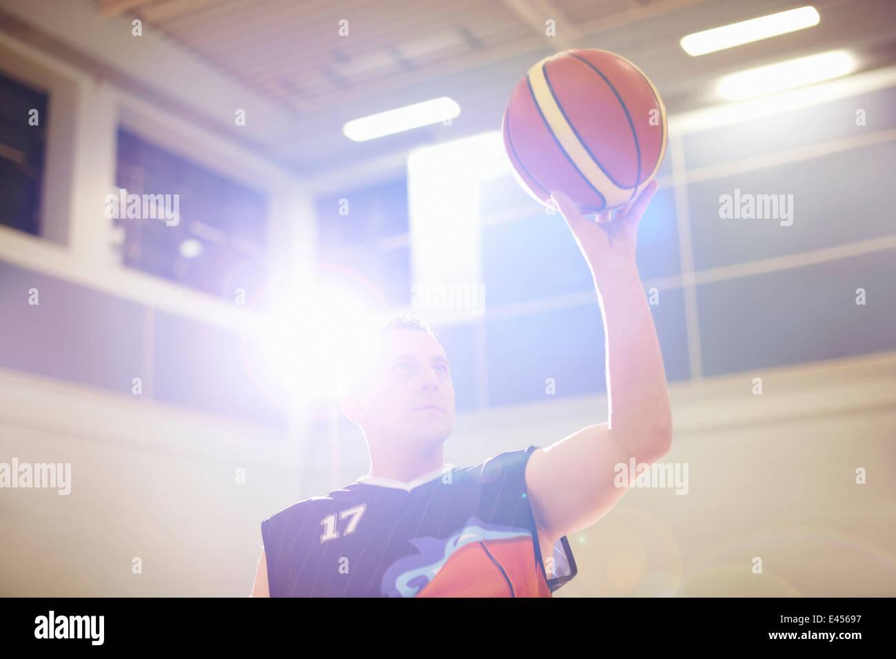 Wheelchair basketball player aiming ball - Stock Image
