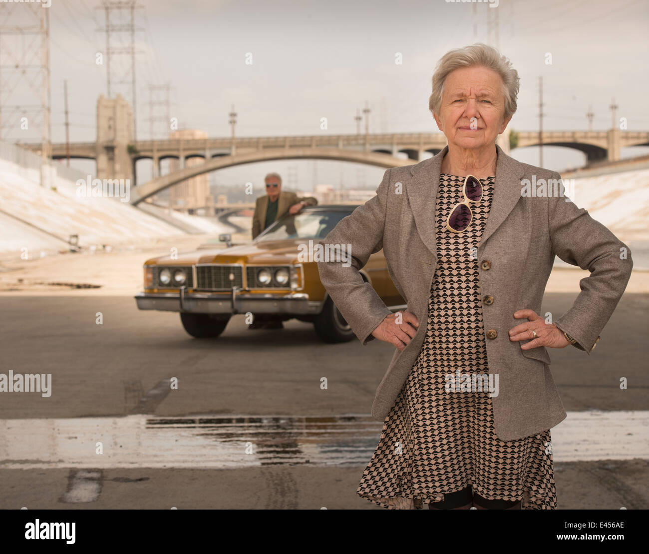 Portrait of cool senior woman and husband with classic car, Los Angeles, California, USA - Stock Image