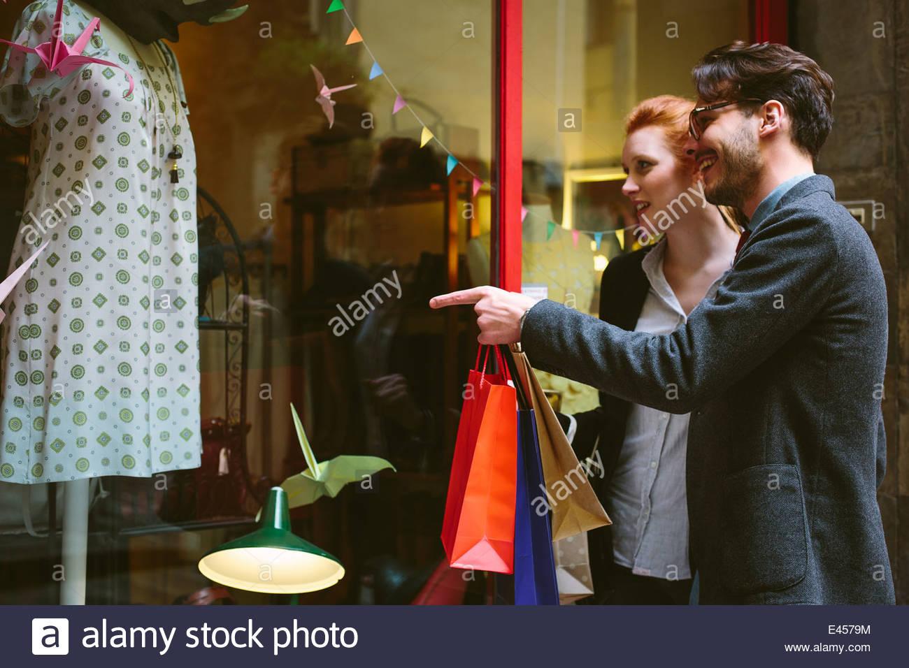 Couple window shopping, Florence, Italy - Stock Image