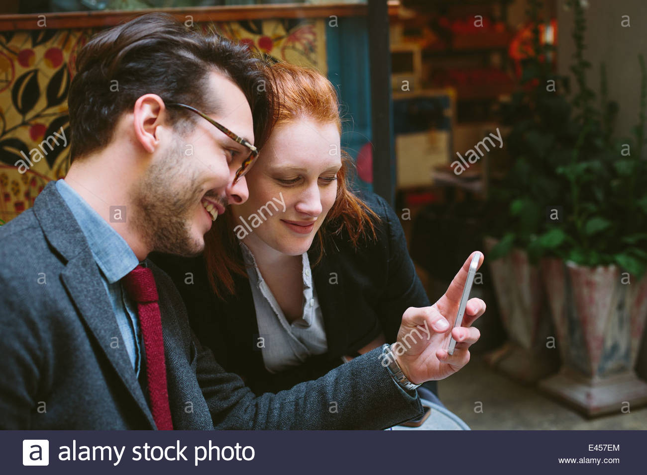 Couple looking at smartphone - Stock Image