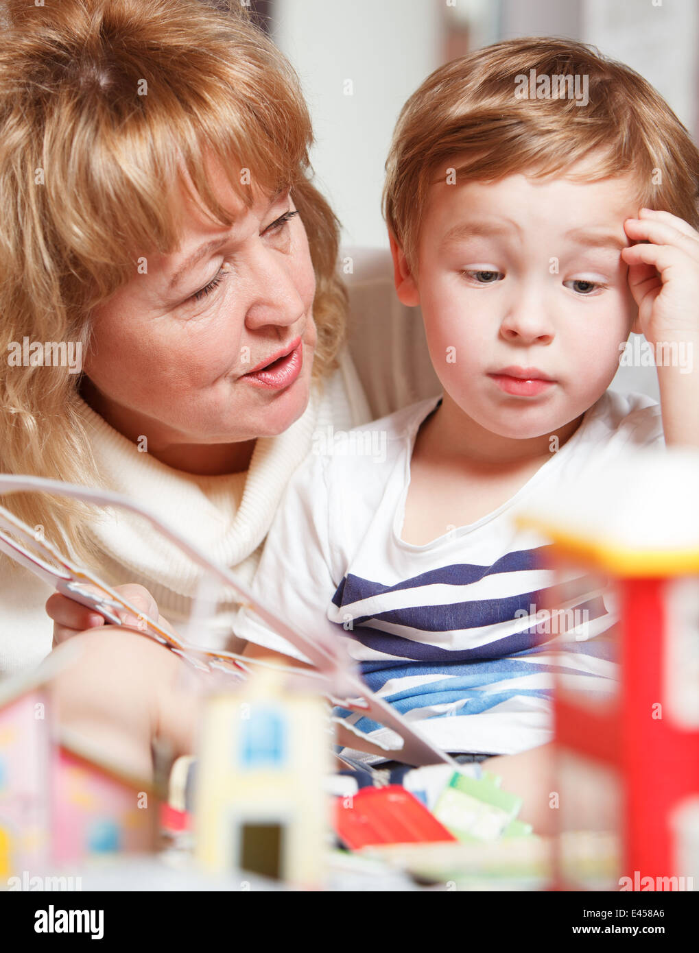 Grandma and puzzled boy - Stock Image