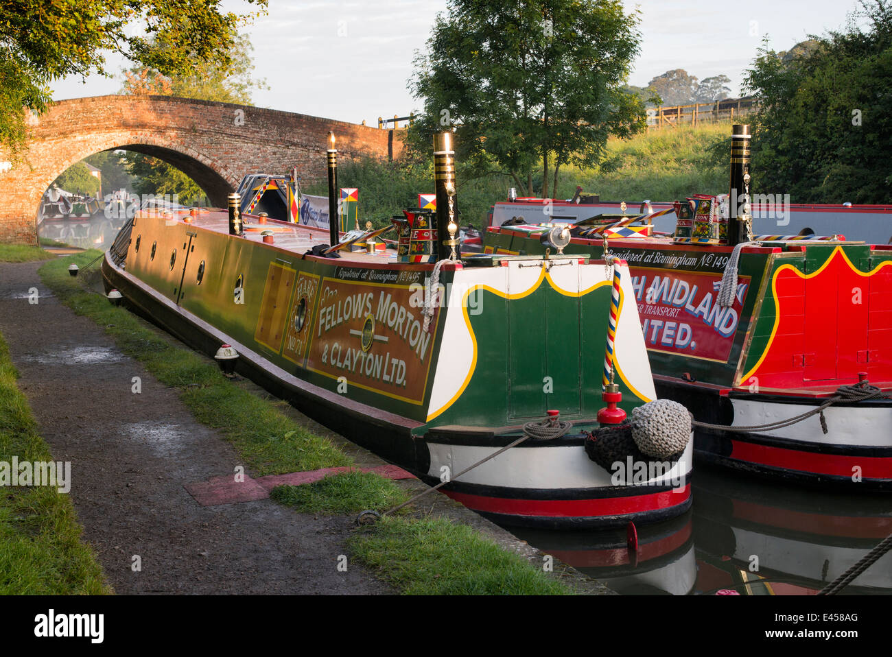 Narrowboats at Braunston Historic Canal Rally on the Grand Union canal at sunrise.  Braunston, Northamptonshire, - Stock Image