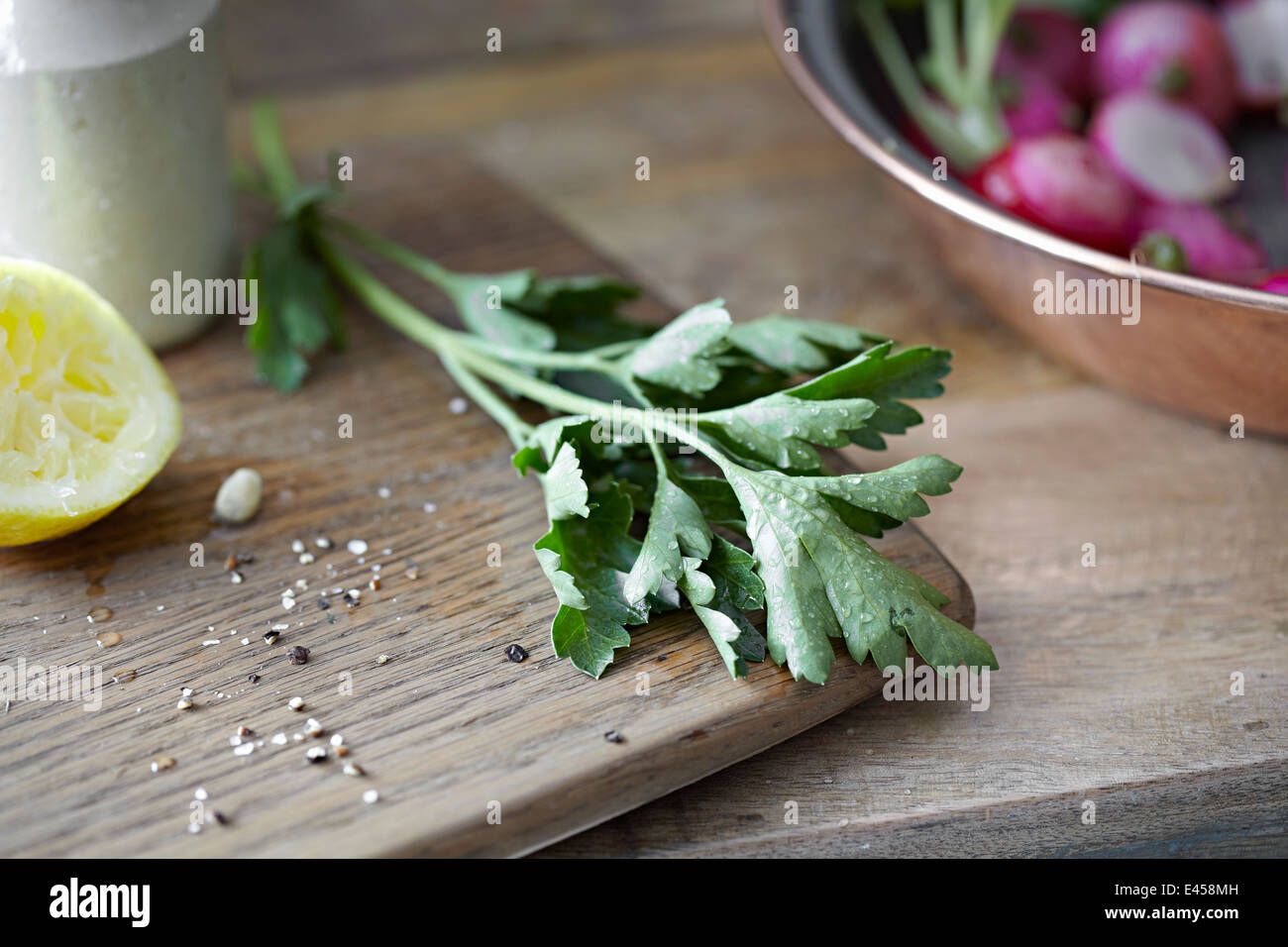 Fresh radishes, herbs and lemon - Stock Image