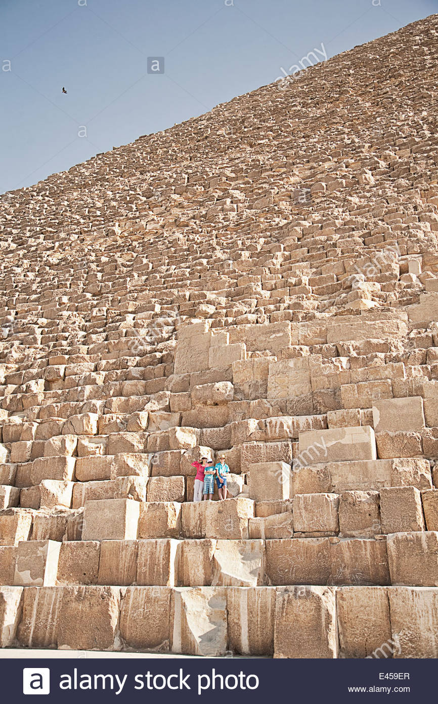 Mother and sons, tourists at The Great Pyramid of Giza, Egypt - Stock Image