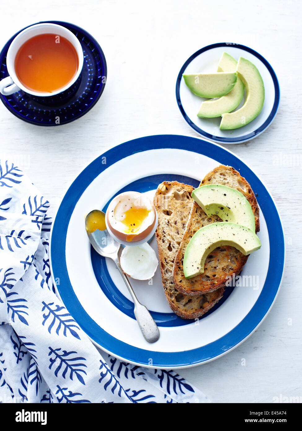 Boiled egg with toast and avocado - Stock Image