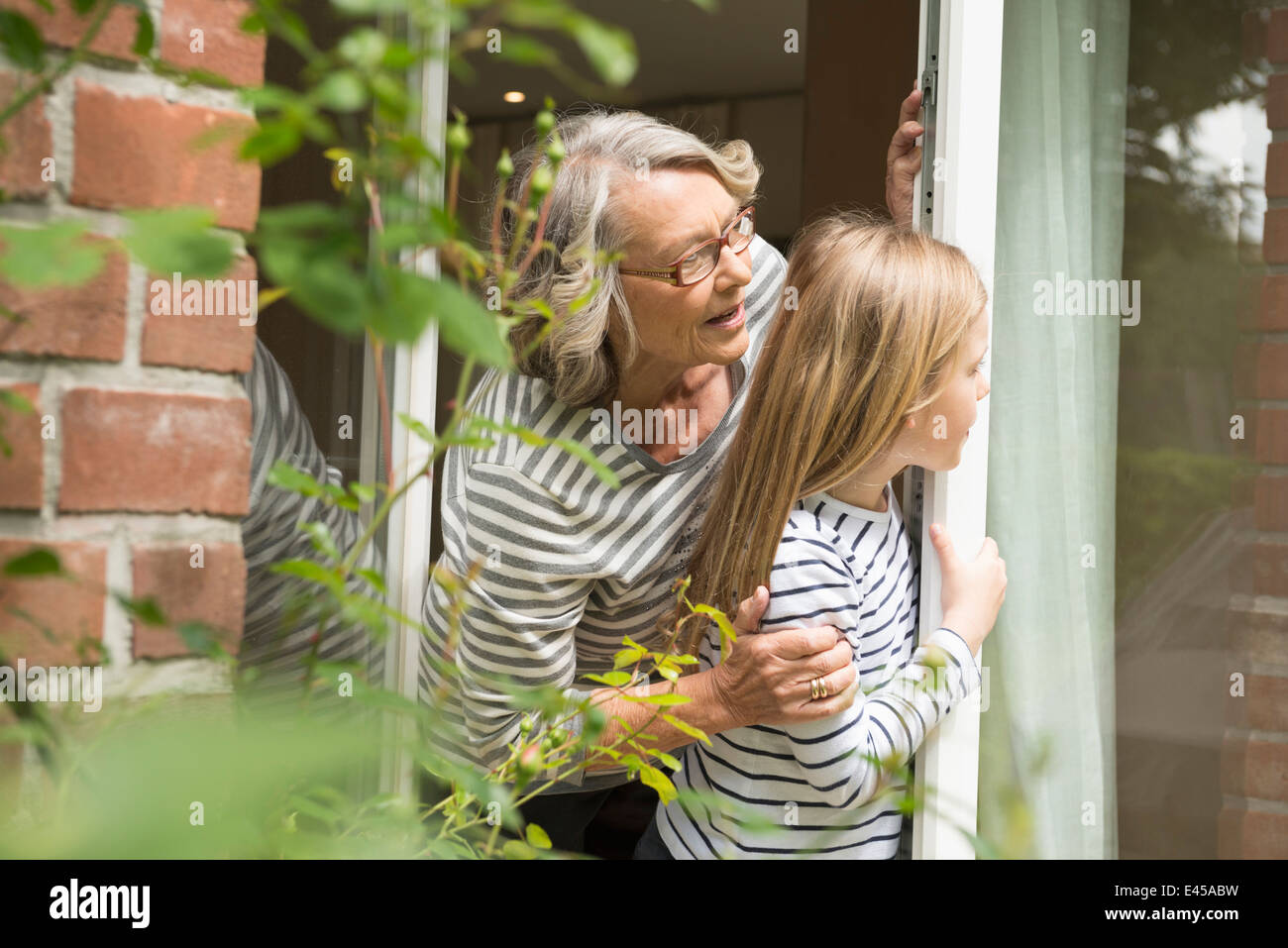 Grandmother and granddaughter bonding - Stock Image