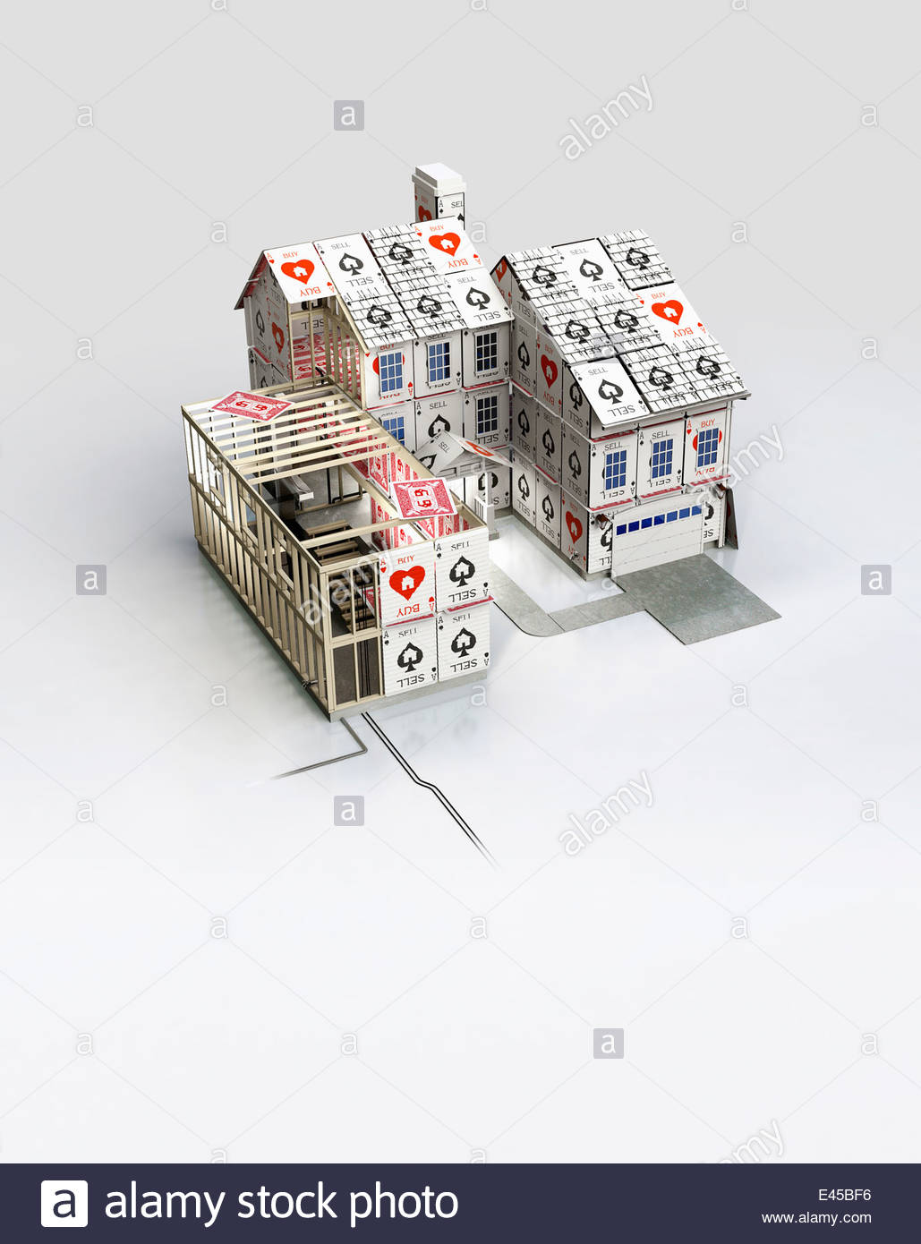 House constructed of buy and sell playing cards - Stock Image