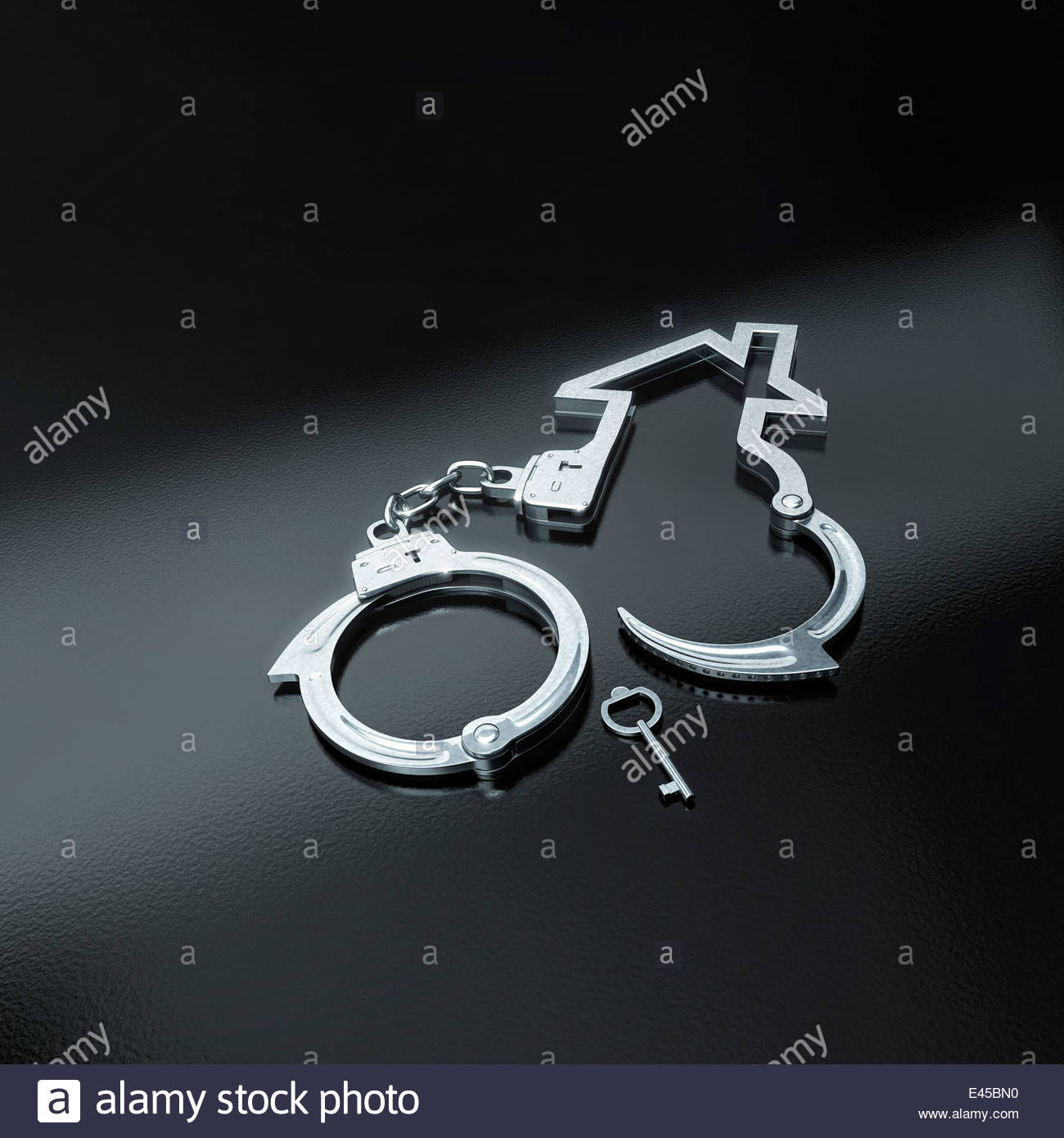 Outline of house in handcuffs - Stock Image