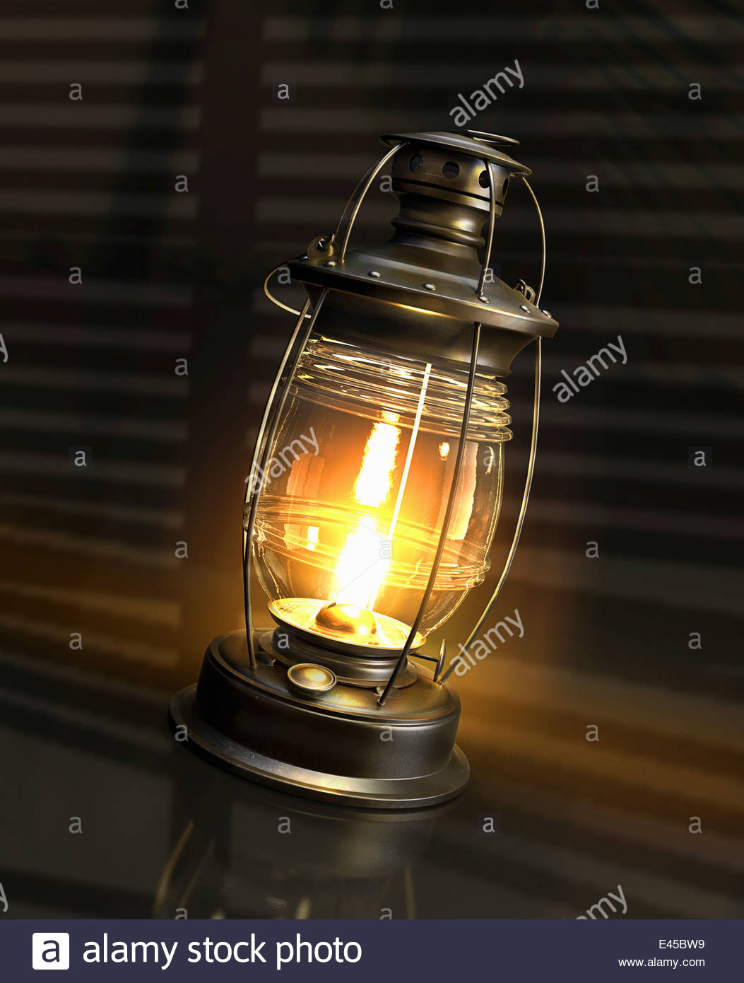 Illuminated glowing paraffin lamp - Stock Image