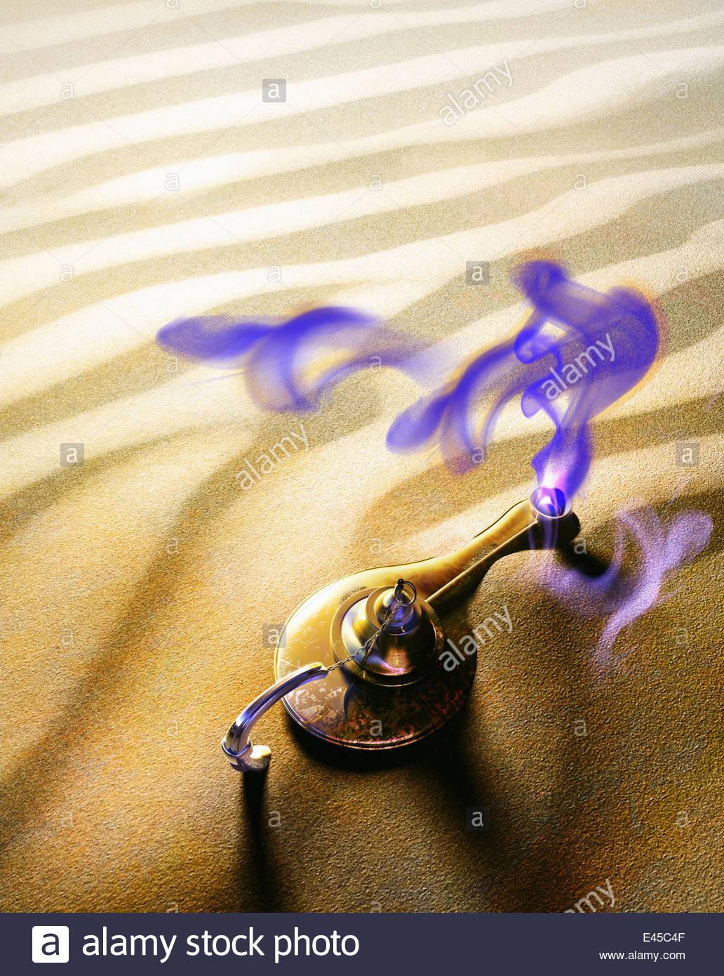 Purple smoke rising from magic lamp in desert - Stock Image