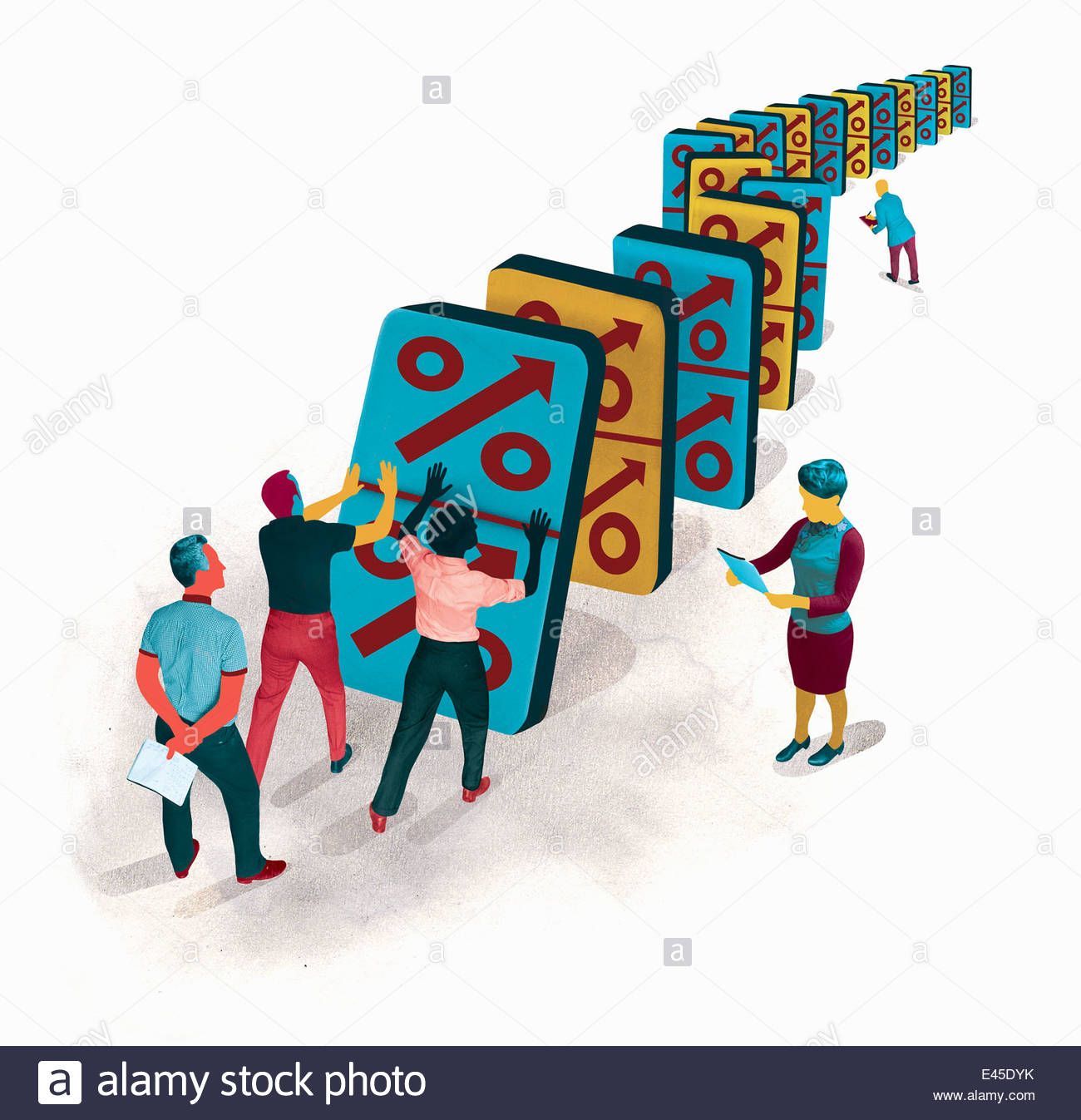 Business people pushing falling percentage symbol dominos in domino effect - Stock Image
