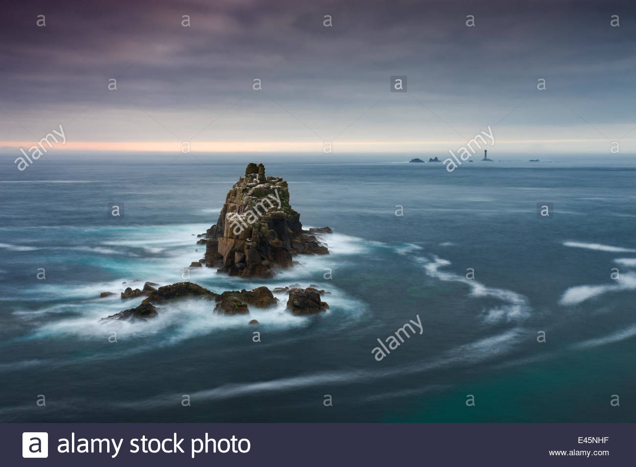 The Armed Knight rock stack and Longships Lighthouse off the coast at Land's End, Cornwall, England. May 2009. - Stock Image