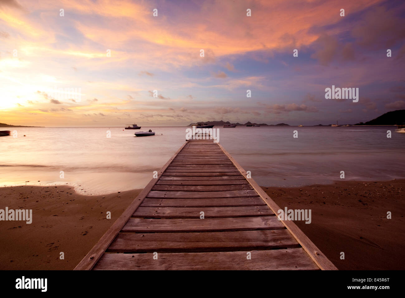 Pontoon at sunset in the Grenadines, Caribbean. February 2010. - Stock Image