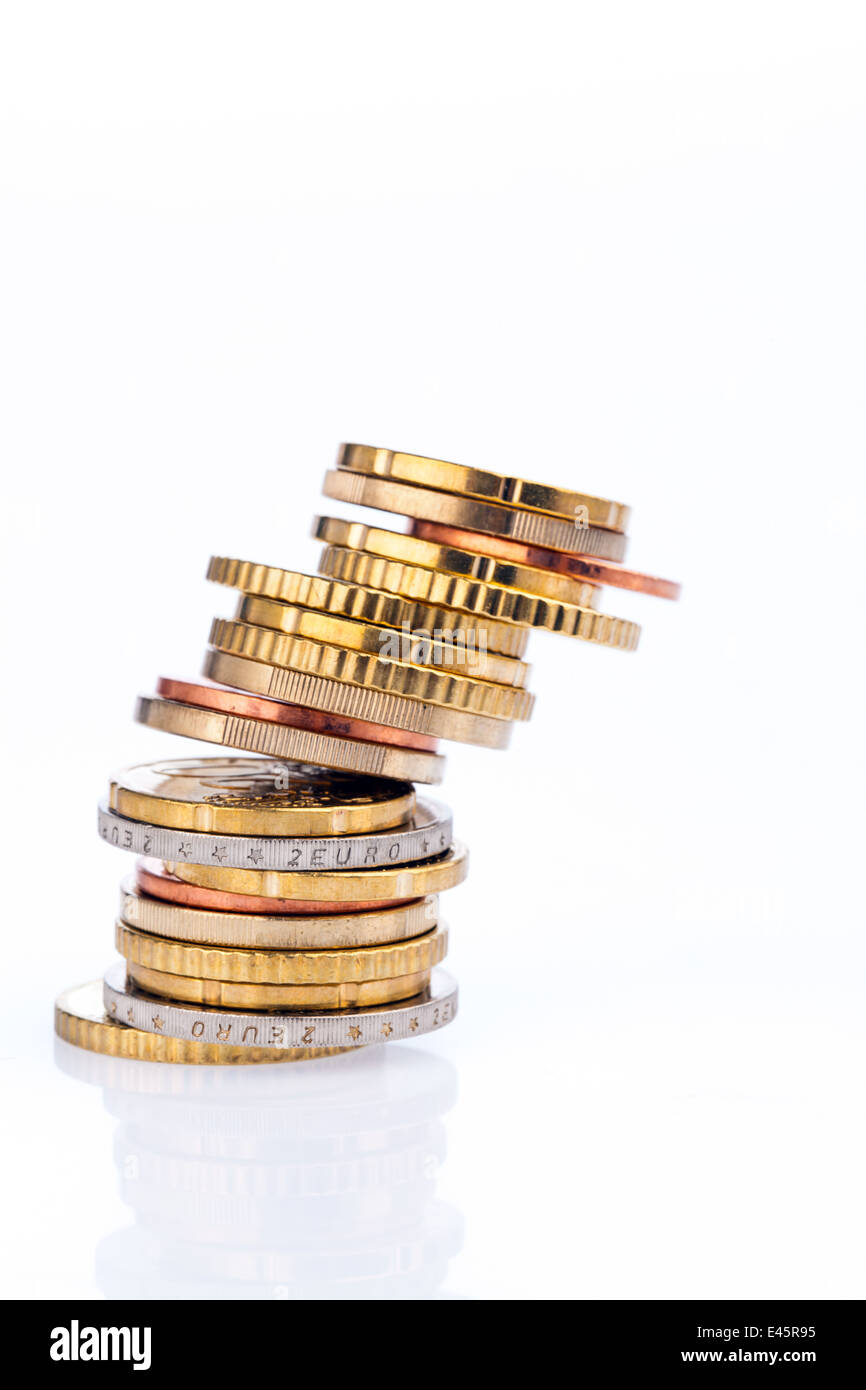 A toppling stack of coins of euro cents.Isolated on white background Stock Photo