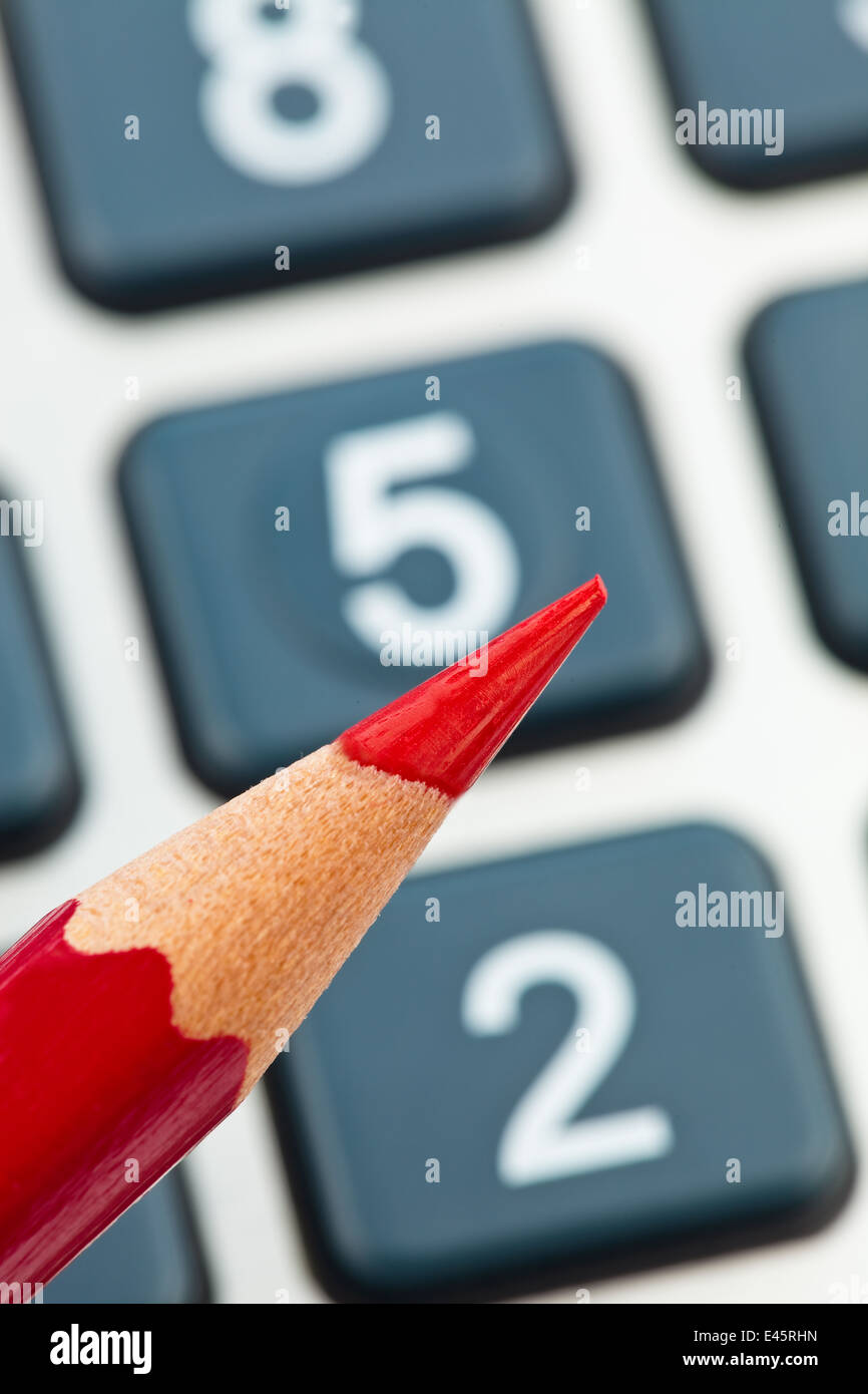 A red pencil and a calculator. image icon for streamline and economize Stock Photo