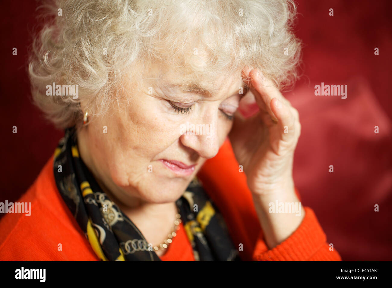 A close up of a stressed senior woman. - Stock Image