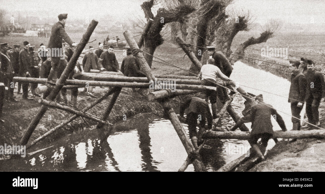 Civilians using their daily trades, in this case bridge building, during WWI. - Stock Image