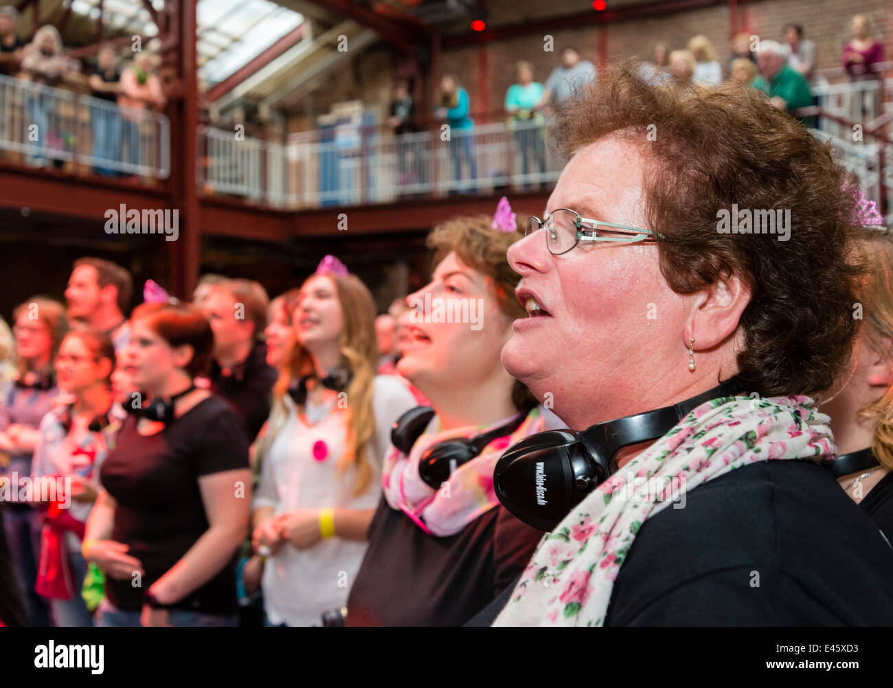 Cheerful participants enjoy 'Rudelsingen', coming together to sing at 'Extraschicht' - the annual - Stock Image