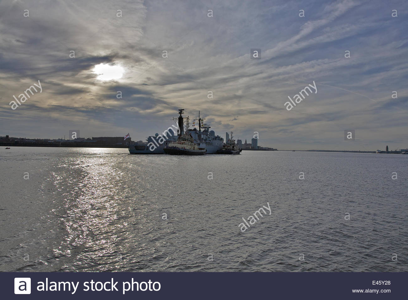 Tugs 'Switzer Maltby' and 'Switzer Stanlow' assisting 'HMS Liverpool' as she arrives in - Stock Image