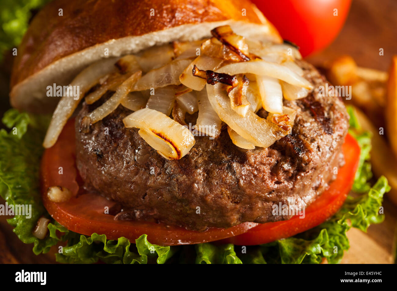 Gourmet Hamburger with Lettuce Tomato and Onions - Stock Image