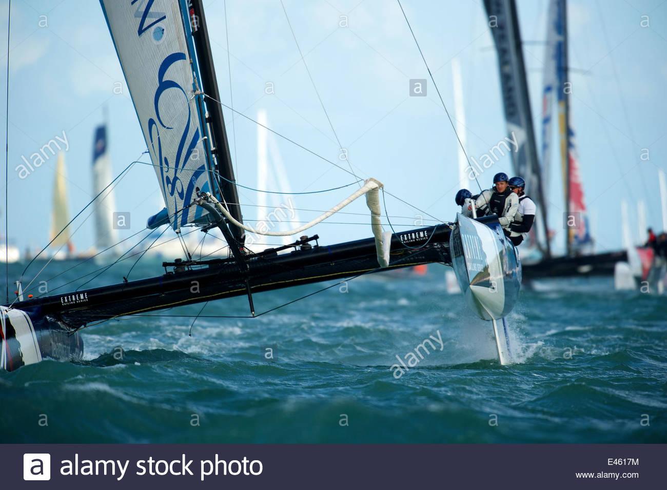 """""""The Wave Muscat"""" leading the fleet on day two of the Extreme 40 Sailing Series in Cowes. Isle of Wight, England, Stock Photo"""
