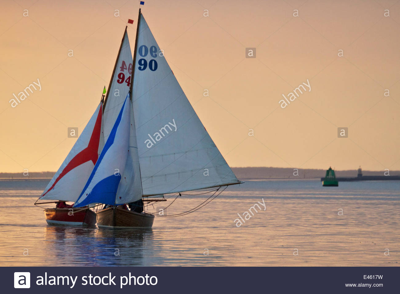 Two small sailing boats during evening regatta on the River Mersey. Liverpool, England, July 2011. - Stock Image