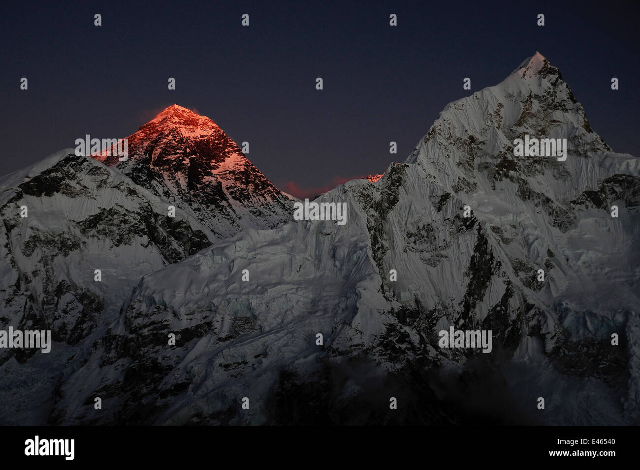 The last light of day illuminating the summit of Mount Everest, Sagarmatha National Park, Khumbu, Himalayas, Nepal, - Stock Image