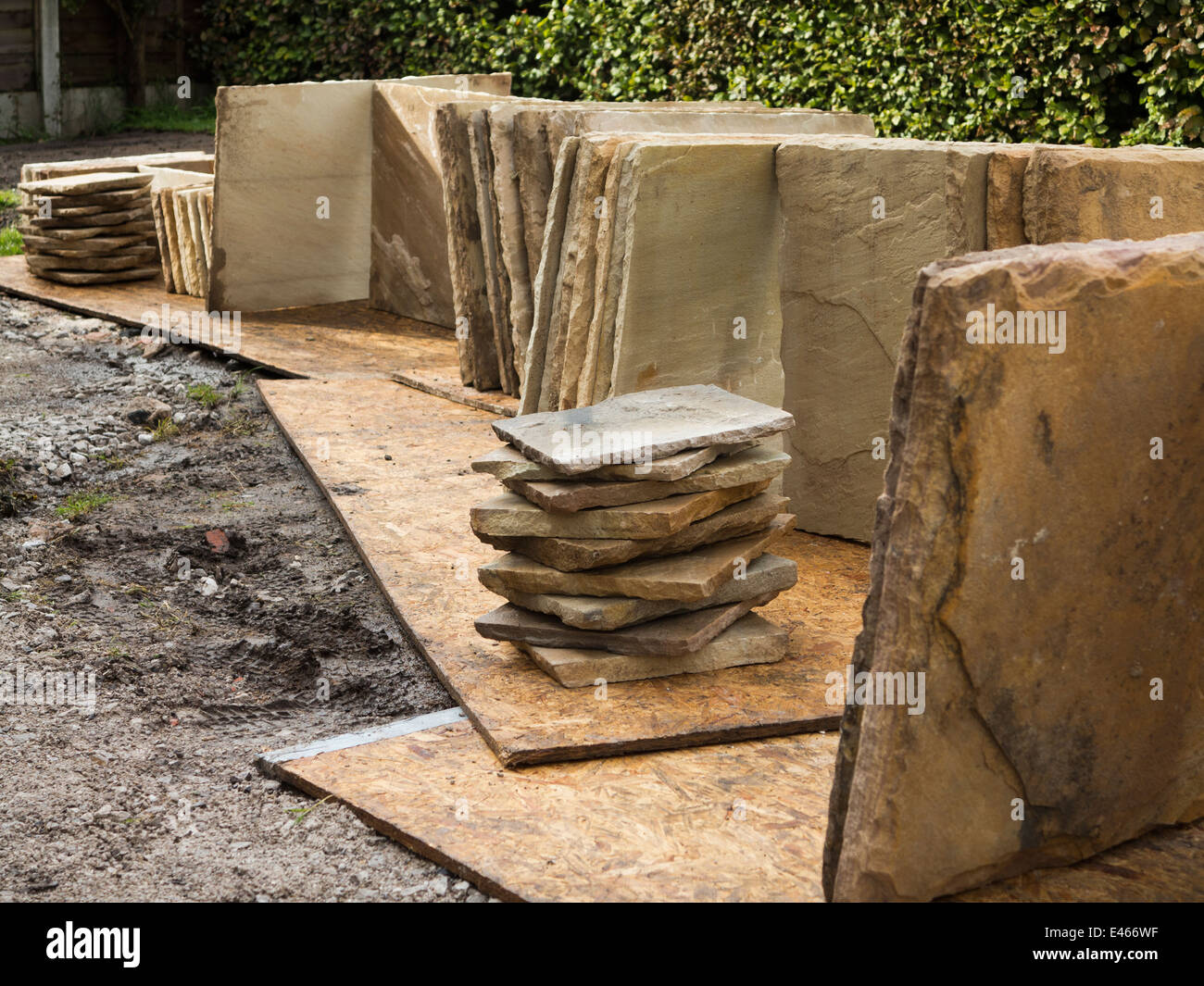 self building house, natural Indian stone slabs stacked in position ready for paving Stock Photo