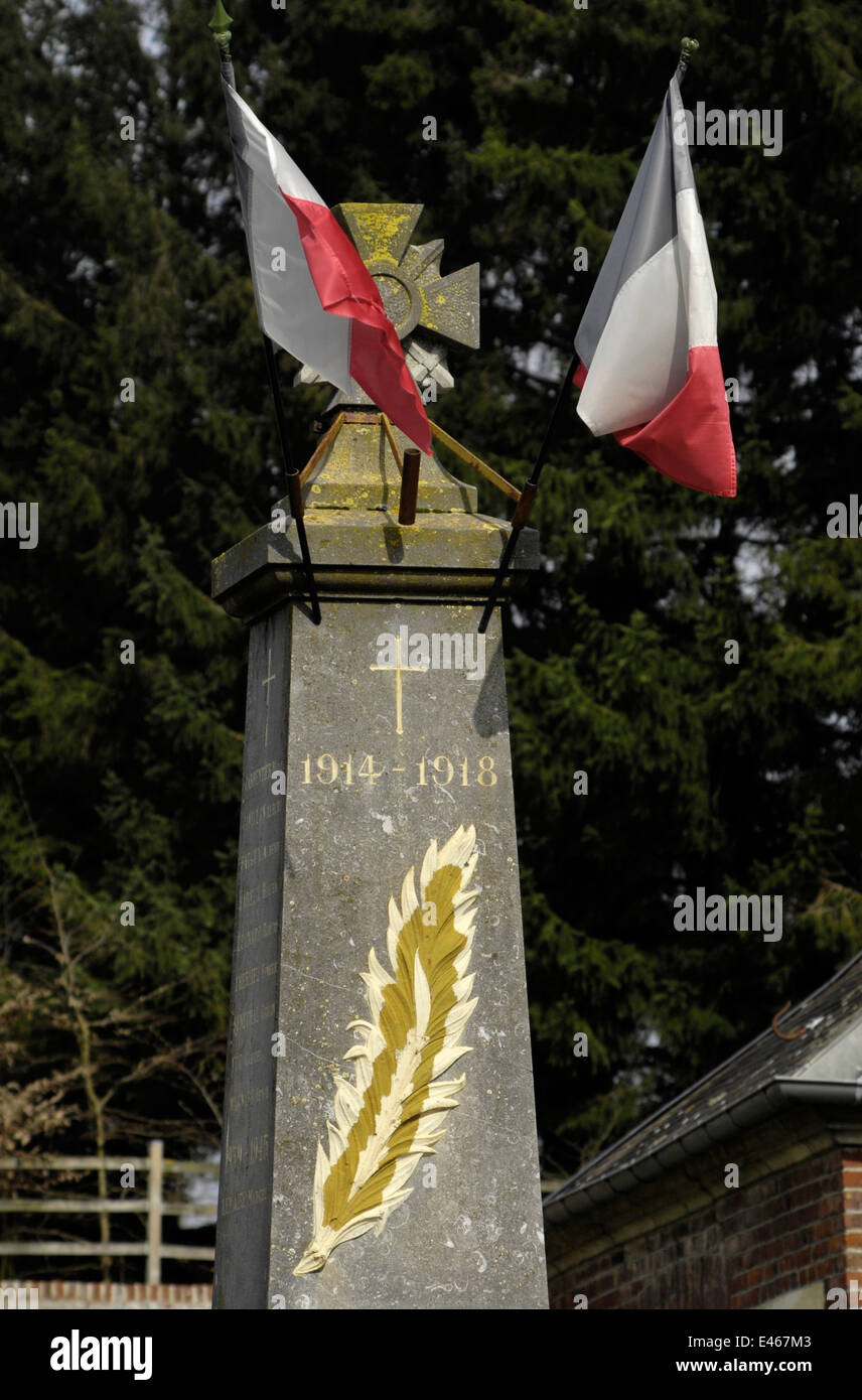 CHUIGNOLLES, FRANCE-TRICOLOURS FLUTTER IN A SPRING BREEZE ON FIRST WORLD WAR MEMORIAL.PHOTO:JONATHAN EASTLAND/AJAX - Stock Image