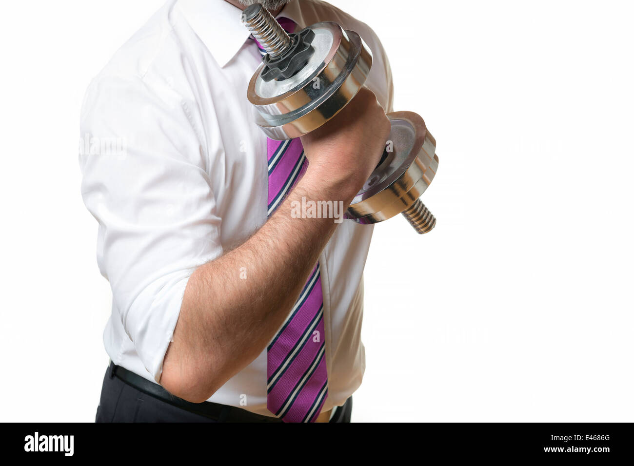 Businessman holding a silver dumbbell in the right hand - Stock Image