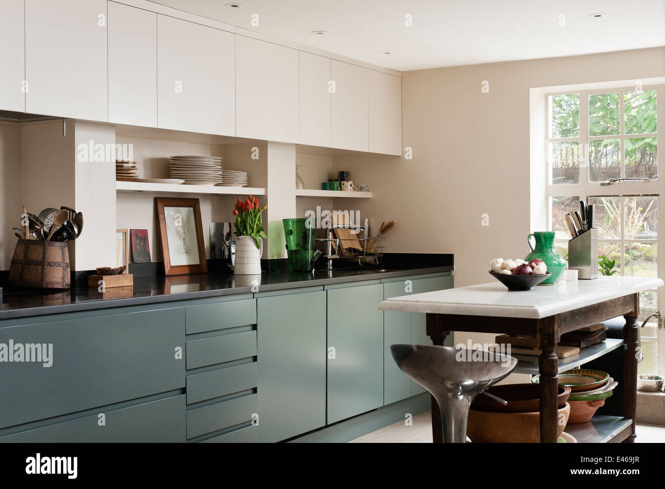 London home, kitchen with island and bar stool - Stock Image