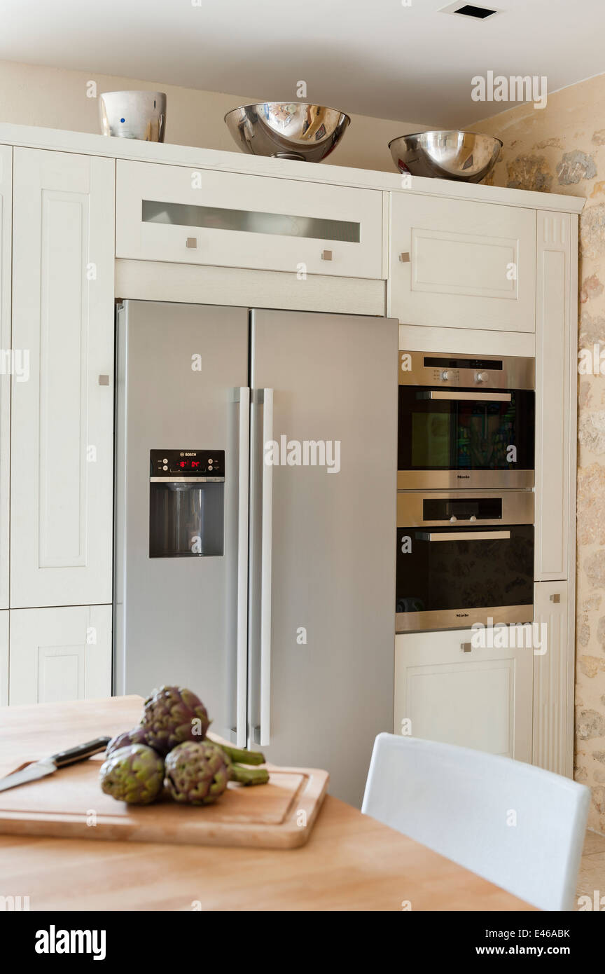 Bosch fridge freezer in an Arthur Bonnet kitchen with Miele microwave - Stock Image