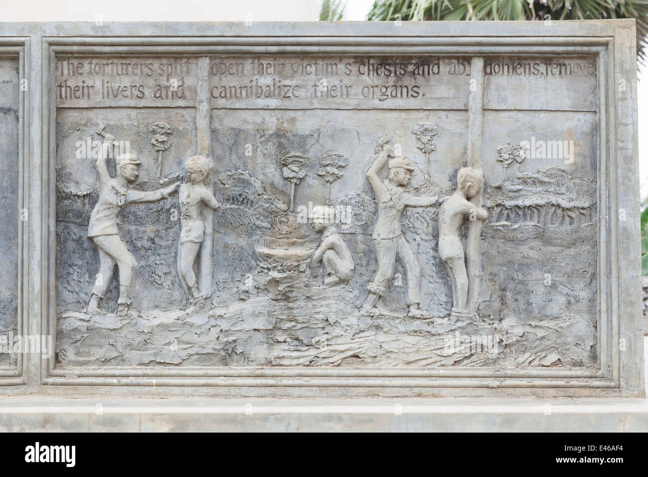 Bas reliefs at a memorial monument depicting the atrocities of the khmer rouge at Wat Samrong Knong near Battambang, - Stock Image