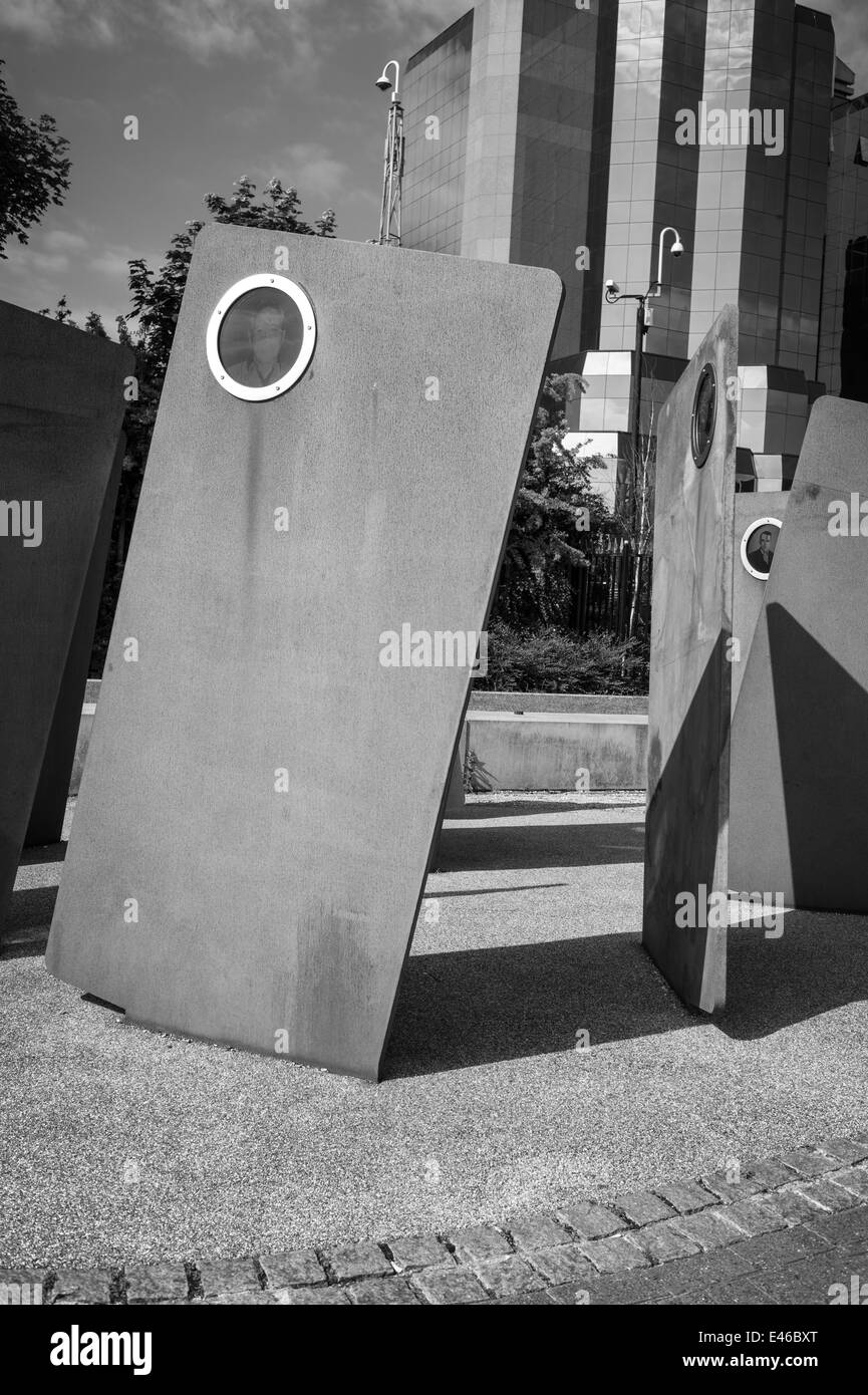Black and white photograph. Close up of The Casuals statue on Salford Quays, Manchester ship canal. Manchester UK - Stock Image