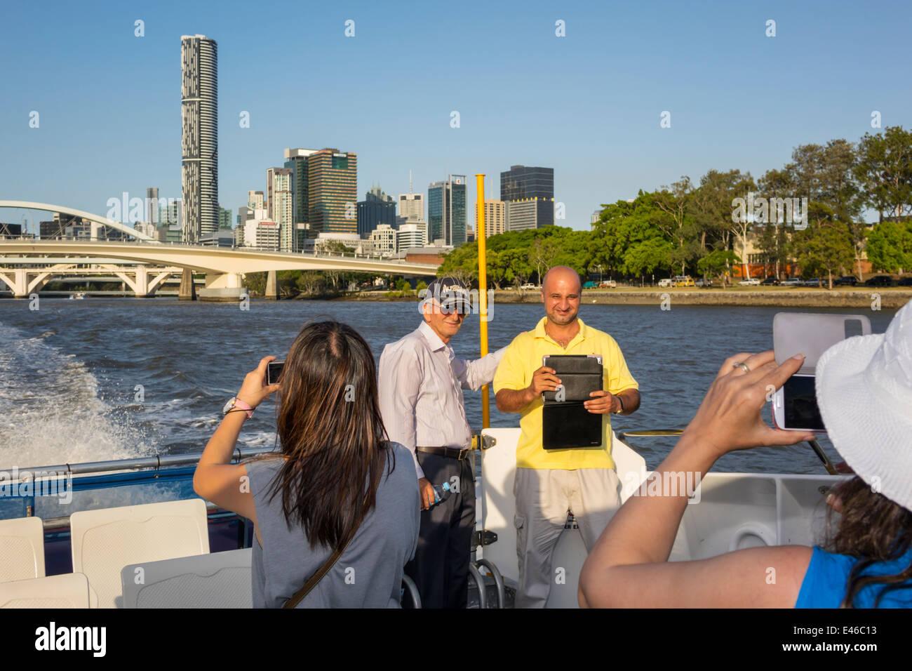 Brisbane Australia Queensland Central Business District CBD city skyline skyscrapers buildings CityCat ferry boat - Stock Image