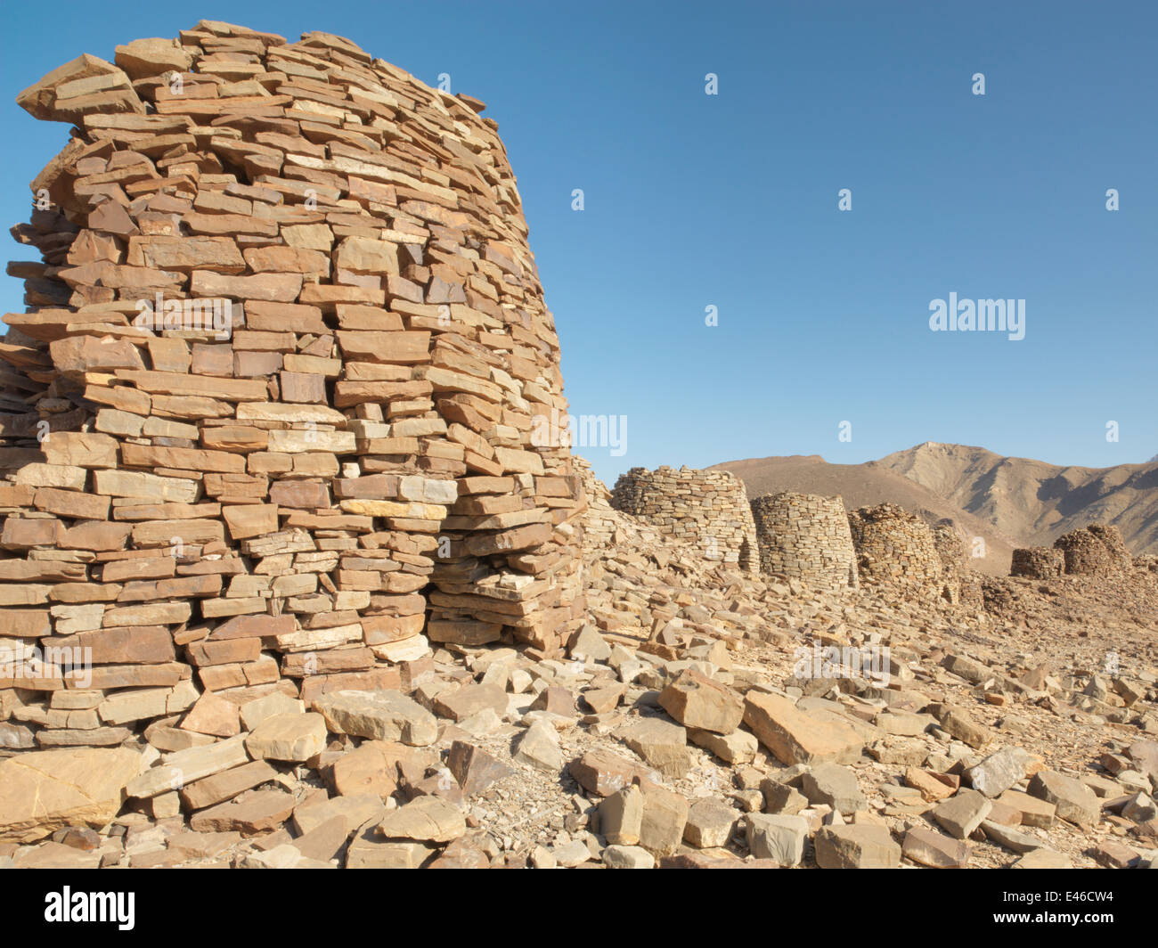 UNESCO World Heritage site in Oman Middle East. Ancient Beehive tombs on a ridge top in the Hajjar mountains near - Stock Image