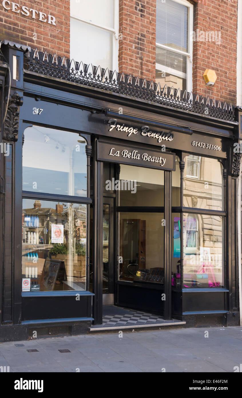 The city of Gloucester  Fringe Benefits Hair Salon - Stock Image