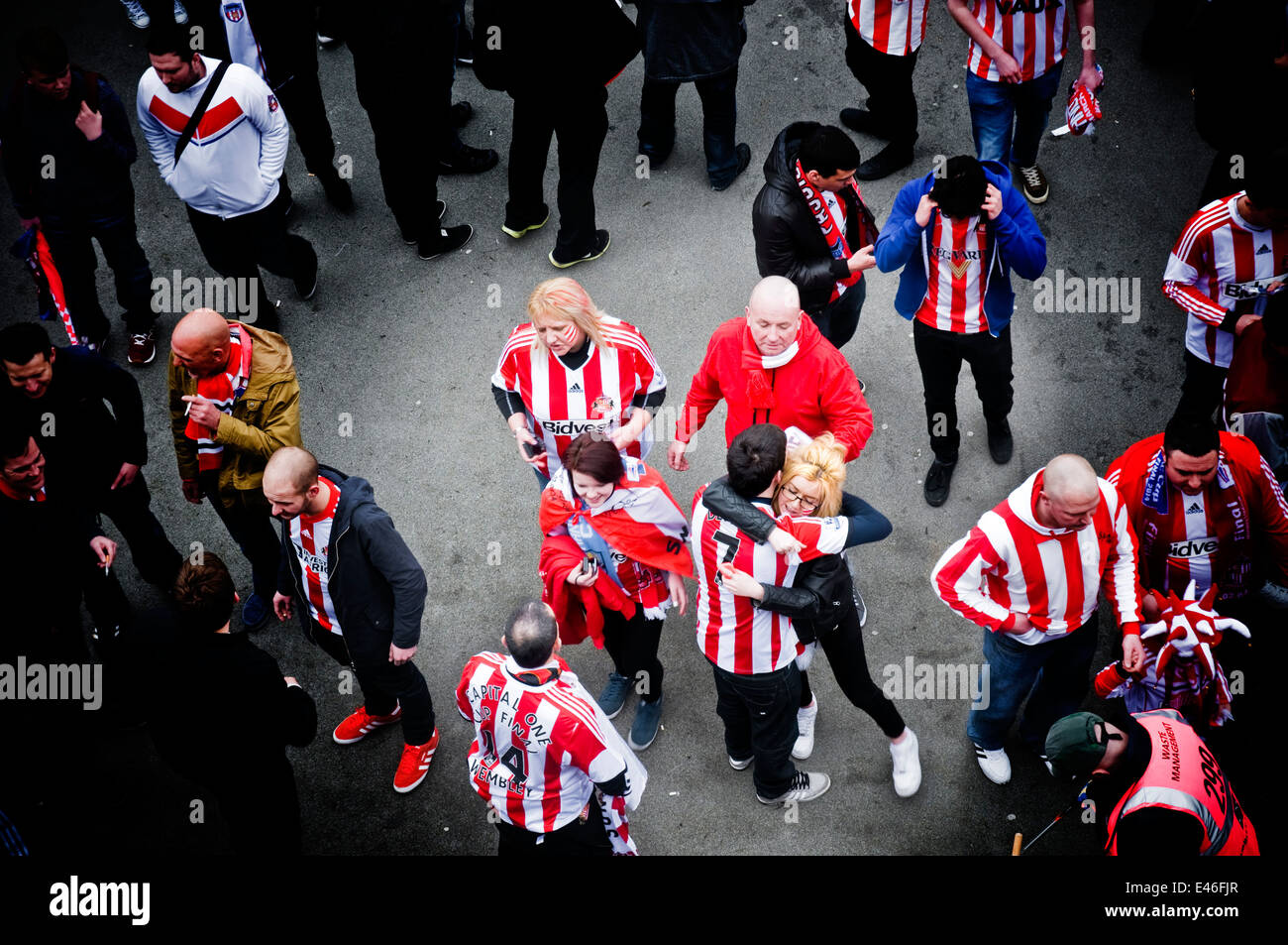 Sunderland football fans hug each other before watching their team take on Manchester City at Wembley in the 2014 - Stock Image
