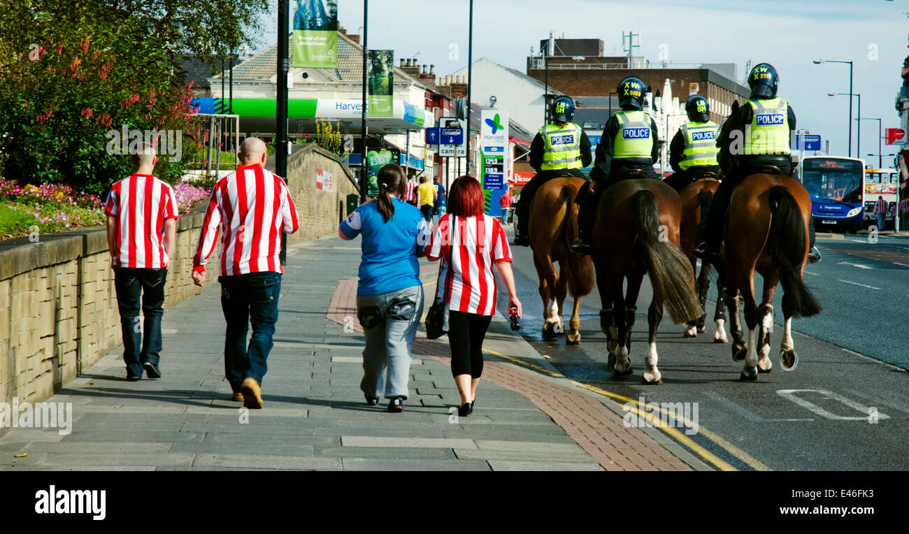 Four supporters walk to the Stadium of Light to watch Sunderland AFC - Stock Image
