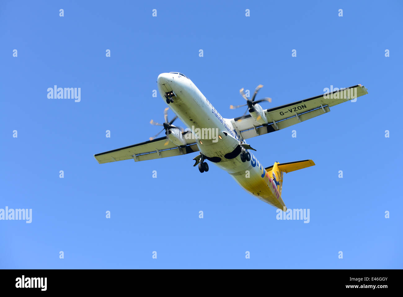 Aurigny airline services aeroplane in flight over Guernsey - Stock Image