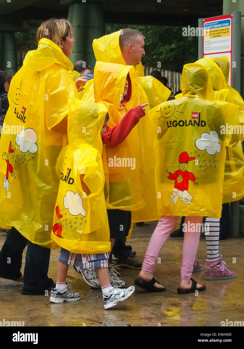 Visitors to legoland windsor wearing disposable waterproof ponchos on a rainy day - Stock Image