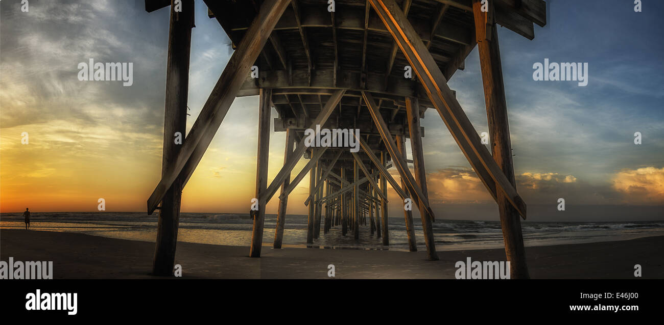 A dramatic sunrise panoramic view of The Jolly Roger Pier at Topsail Beach North Carolina Stock Photo