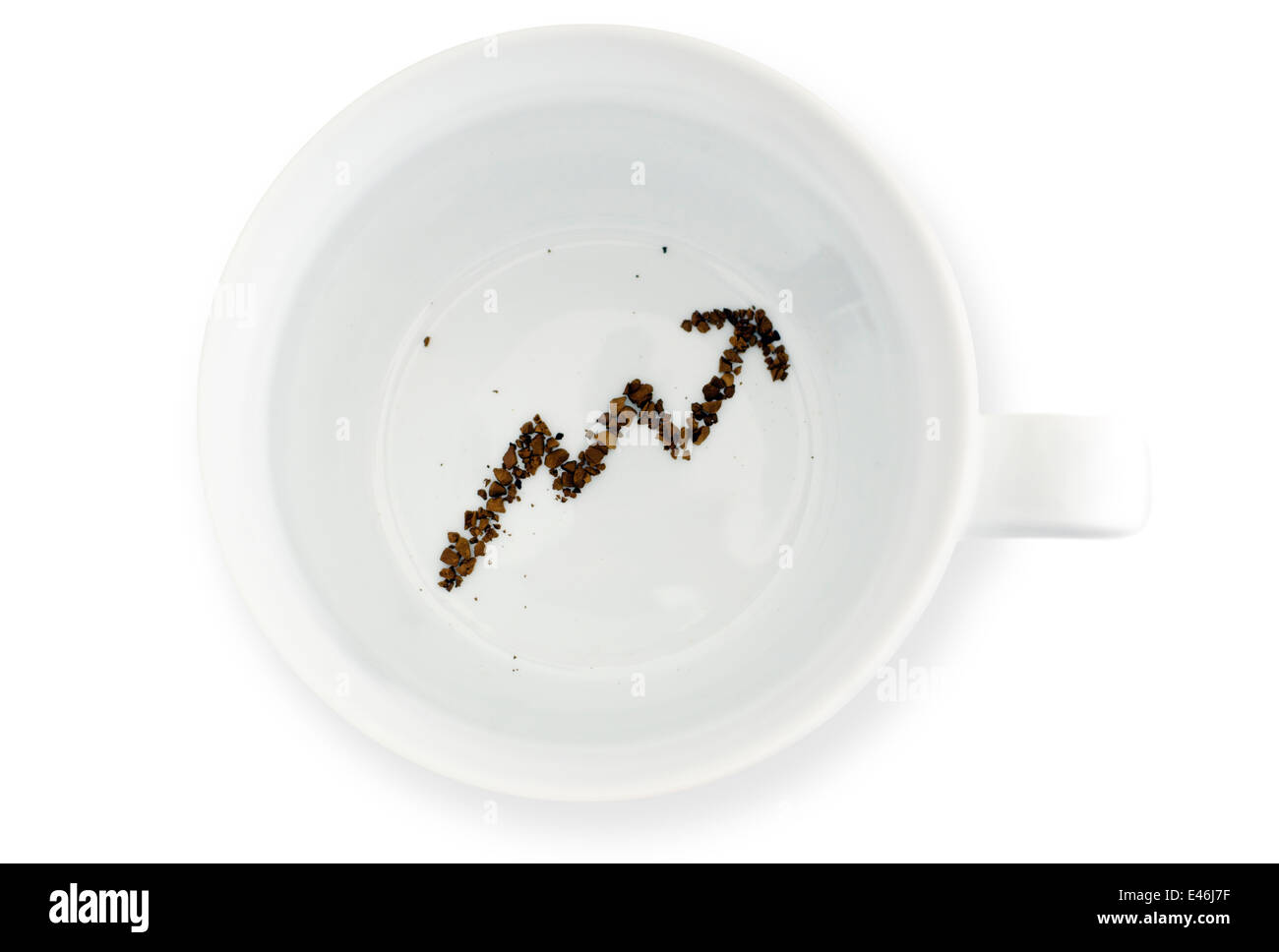 Coffee grounds in coffee mug, reads the future for investment. Concept photo of future fortune telling about money - Stock Image