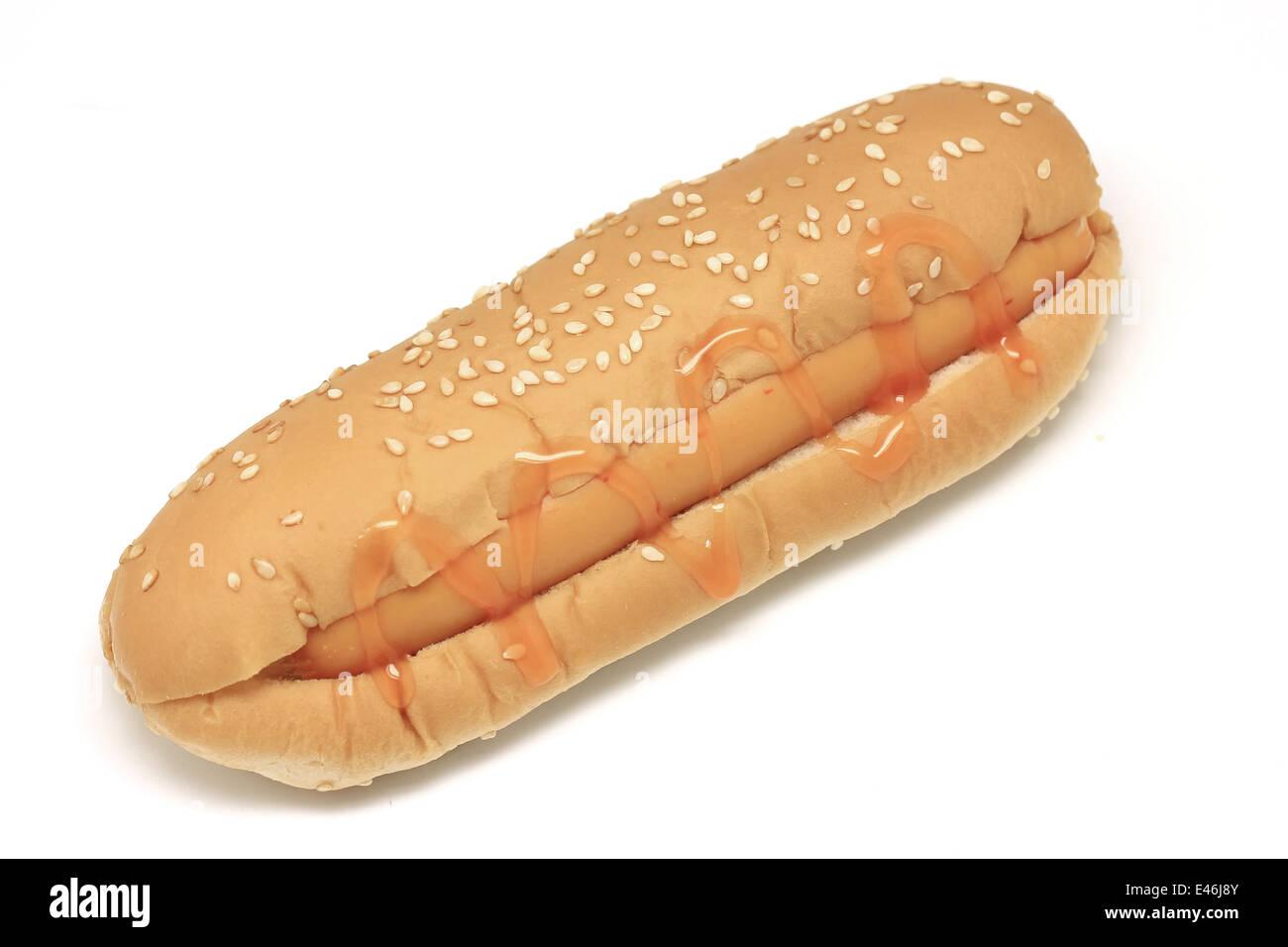 hotdog with tomato sauce isolated on white background - Stock Image