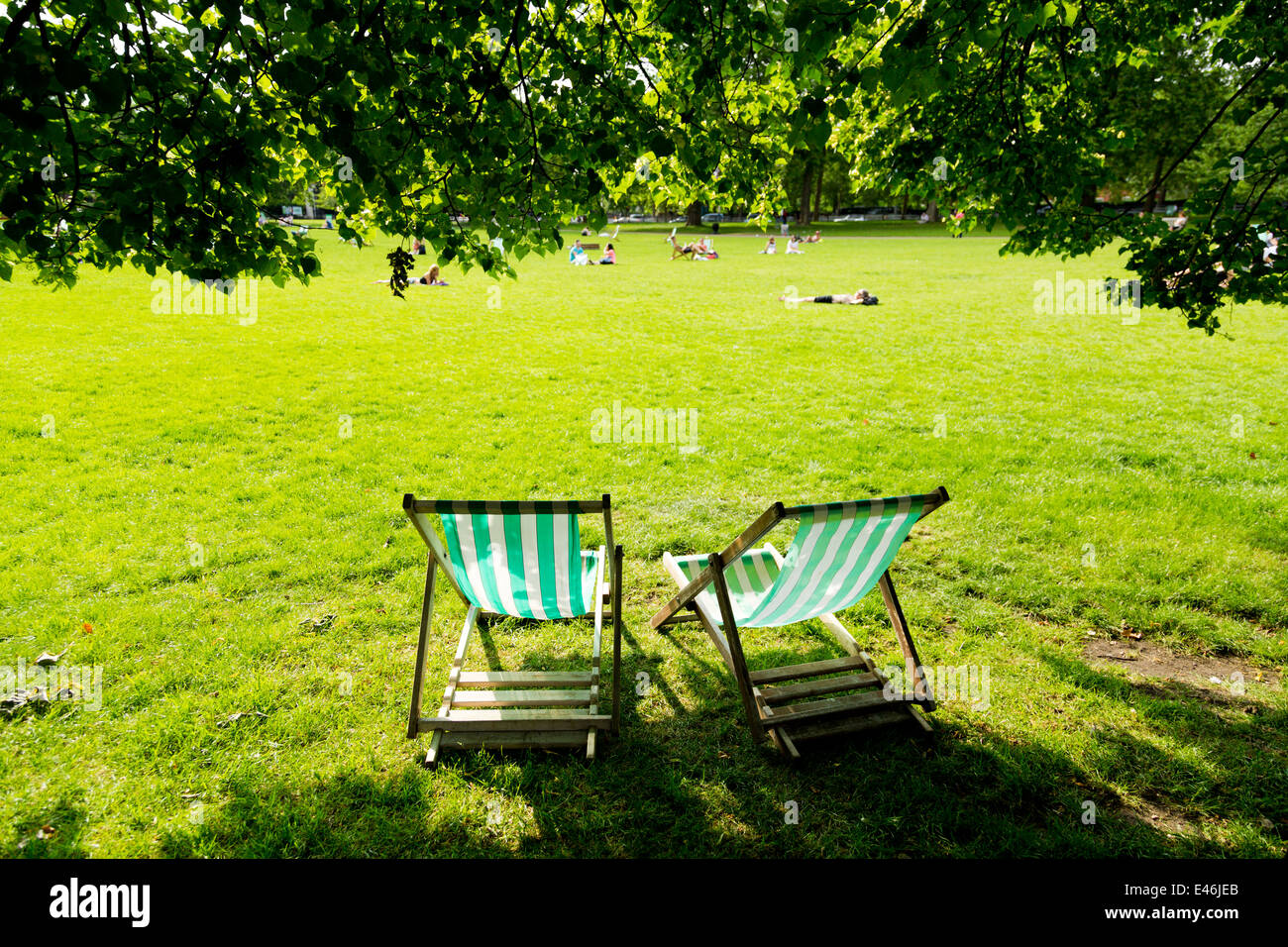 Deckchairs at London St. James's Park on a sunny day, England - Stock Image