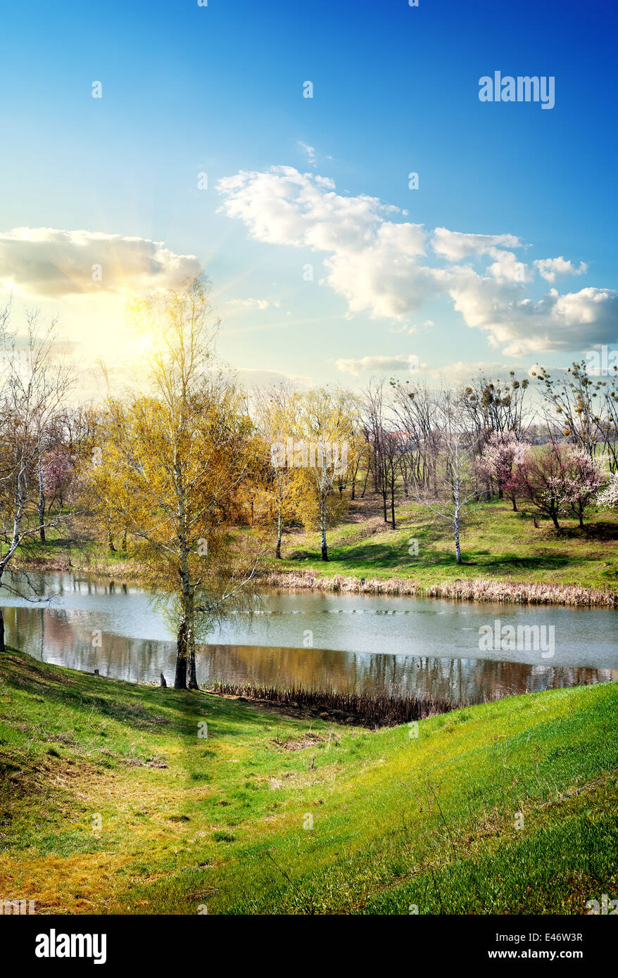 Beautiful river and blue sky in early spring - Stock Image