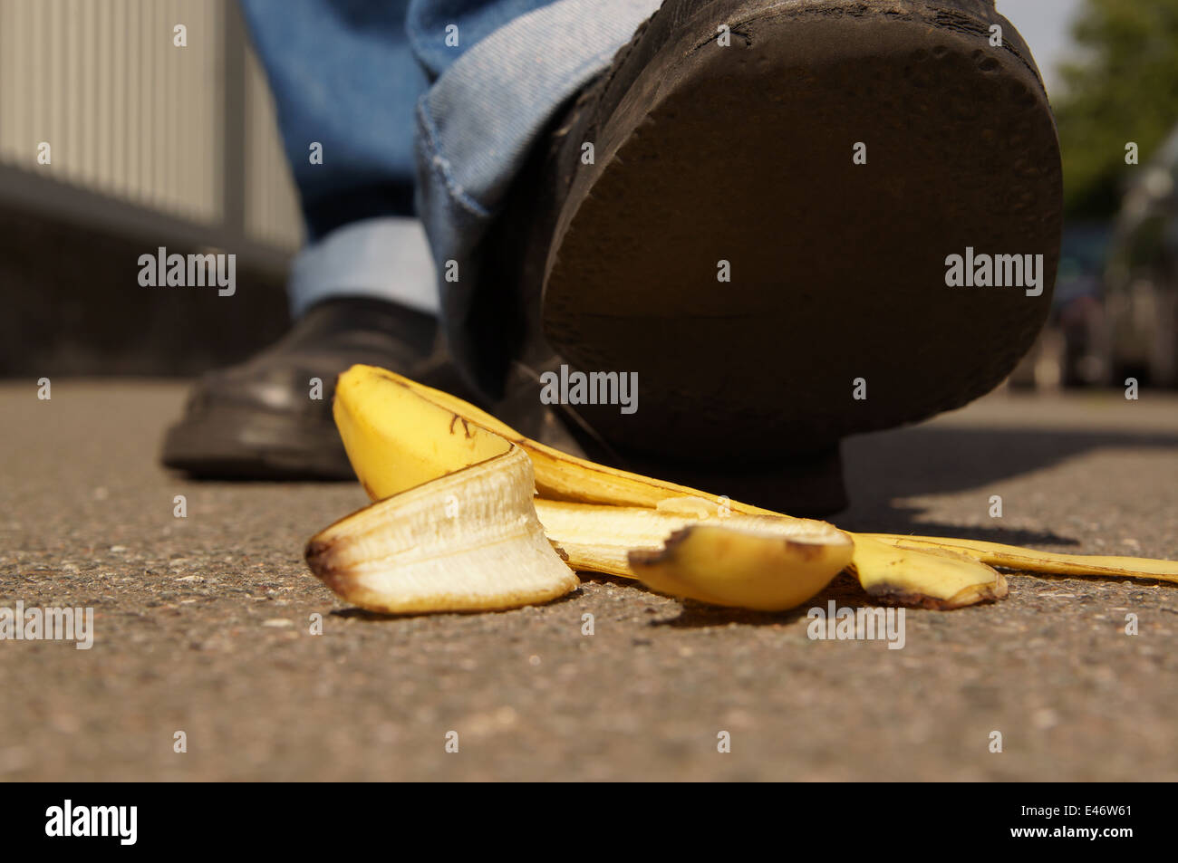 slipping on a banana skin - Stock Image