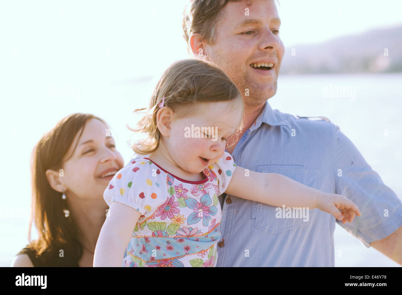 Family of three by the sea - Stock Image