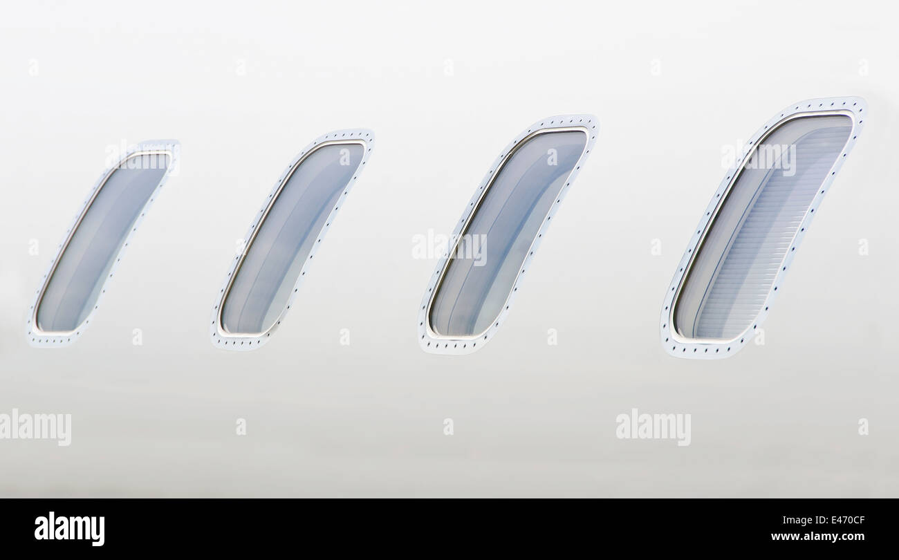 Windows on a luxury private aircraft - Bombardier Global Express - Stock Image