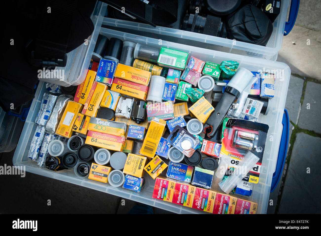 A box of old retro out of date 35mm and 120 format black and white and colour negative and slide film on sale on - Stock Image
